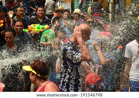 CHIANG MAI, THAILAND - APRIL 15 : People celebrating Songkran or water festival in the streets by throwing water at each other on 15 April 2014 in Chiang Mai, Thailand
