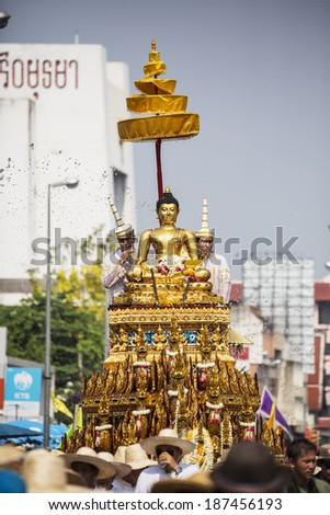 Chiang Mai, Thailand -- April 13, 2013 : People splash scented water to bath Phra Phuttha Sihing, the famous Buddha Image, blessing on Songkran, known as Water Festival and Thai New Year Ceremony.