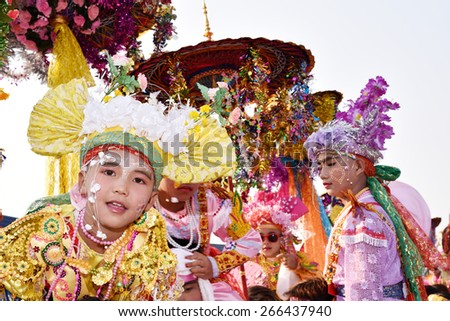 CHIANG MAI, THAILAND - APRIL 04 : Poy Sang Long festival, A Ceremony of boys to become novice monk, In parade around Ku Man temple on April 04, 2015 in Chiang mai, Thailand.  - stock photo