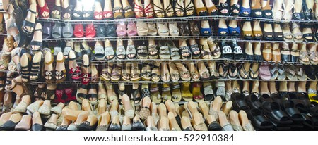 CHIANG MAI, THAILAND - APRIL 17: shelves full of shoes in a shop near Warorot Market on April 17, 2016 in Chiang Mai, Thailand. Chiang Mai is Thailand's northern capital.