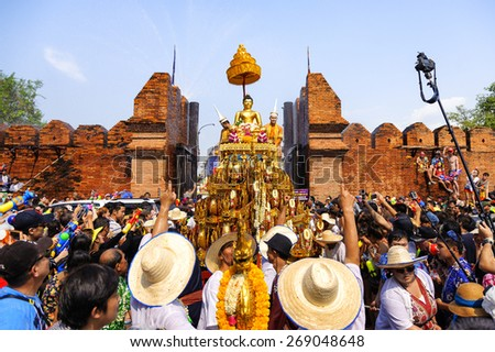 CHIANG MAI THAILAND - APRIL 13 : Songkran festival. Travelers from Thai & foreigners bathing the Buddha's parade to the prosperity of festival at Tha-Pae road. on April 13, 2015 in Chiangmai,Thailand - stock photo