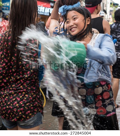 CHIANG MAI, THAILAND - APRIL 13 2015: Songkran (Thai New Year Celebration). The annual water festival in Chiang Mai City, Northern Thailand. - stock photo