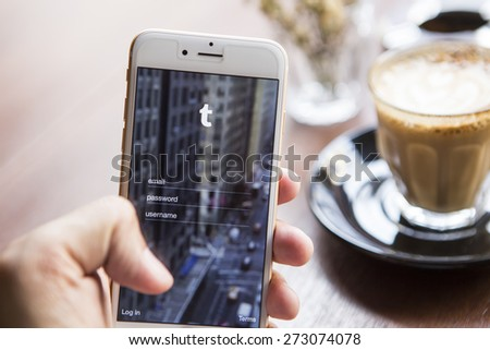 CHIANG MAI, THAILAND - APRIL 22, 2015: Tumblr micro-blogging service that allows users to post text messages on Apple iphone 6, images, videos, links, quotes and audio to their tumblelog. - stock photo