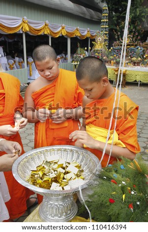 CHIANG MAI  THAILAND - AUGUST 12 : Buddhist metal cast ceremony for buddha statue , Novice collect metal for ancient metal cast ceremony  . Aug 12,2012 in Lok Molee Temple, Chiangmai, Thailand. - stock photo