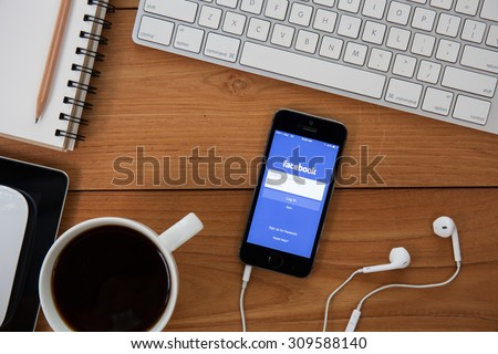 CHIANG MAI,THAILAND - AUGUST 25,2015 :Facebook application sign in page on Apple iPad. Facebook is largest and most popular social networking site in the world. - stock photo