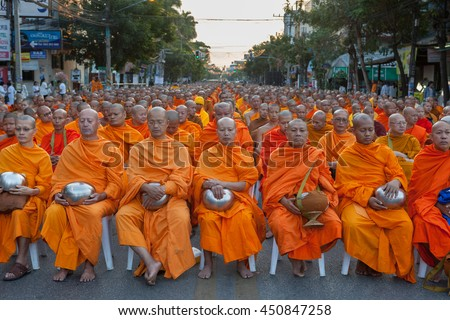 CHIANG MAI, THAILAND - DEC 26 2015: Many thai monks meditating during the traditional Buddhist alms giving ceremony in the early morning. Annual 10 000 Buddhist monks gathering. - stock photo