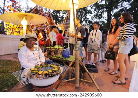 CHIANG MAI THAILAND - DECEMBER 26 : Ancient market walking street, Popular tourist food and visit the local fruit market is be held everyday. on December 26, 2014 in Chiang Mai, Thailand. - stock photo
