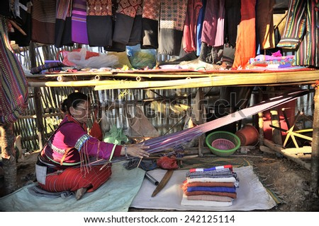 CHIANG MAI THAILAND - DECEMBER 31 : Doi Ang Khang Ethnic Market, Unidentified woman's traditional weaving for the sale to tourists. on December 31 , 2014 in Chiang Mai, Thailand. - stock photo