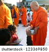 CHIANG MAI,THAILAND-DECEMBER 30 : Many people give food and drink for alms to 12,999 Buddhist monks on December 30,2012 in Chiang mai,Thailand. - stock photo