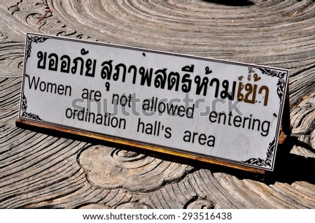 Chiang Mai, Thailand - December 25, 2012: Sign in Thai and English advises that women are not permitted to enter the ordination hall at Wat Sri Suphan