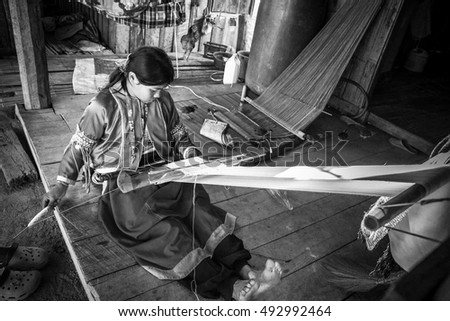 Chiang Mai, Thailand, - December, 21, 2012 : Unidentified name old tribal thai women weaving traditional cotton woven at Doi Inthanon Chiang Mai Thailand.Black and white picture