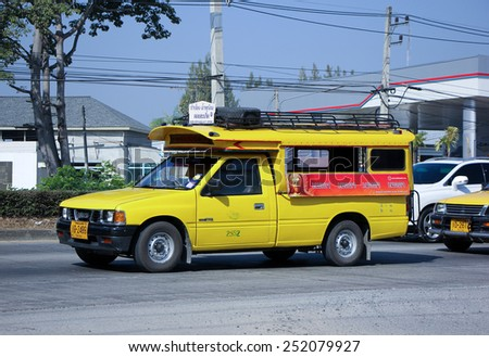 CHIANG MAI, THAILAND - DECEMBER  25 2014:  Yellow mini truck taxi chiangmai, Service between city and Doisaket district.   Photo at road no.1001 about 8 km from city center, thailand.