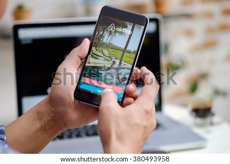 CHIANG MAI,THAILAND ,FEB-23-2016 :Apple iPhone 6 plus Showing Airbnb application on the screen. Airbnb is a website for people to list, find, and rent lodging. - stock photo