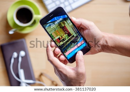 CHIANG MAI, THAILAND - FEB 24 2016: Apple iPhone 6 plus Showing Airbnb application on the screen. Airbnb is a website for people to list, find, and rent lodging. - stock photo