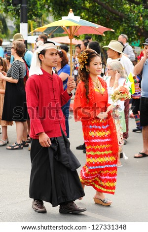 CHIANG MAI,THAILAND-FEB.2 : 37th Anniversary Chiang Mai Flower Festival, Unidentified man and woman in parade annual Chiang Mai flower festival. on Feb.2, 2013 in Chiang Mai,Thailand.