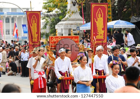 CHIANG MAI,THAILAND-FEB.2 : 37th Anniversary Chiang Mai Flower Festival, Unidentified men and women in parade annual Chiang Mai flower festival. on Feb.2, 2013 in Chiang Mai,Thailand.