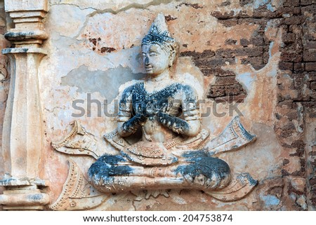 CHIANG MAI, THAILAND - FEBRUARY 9: Ancient Buddha sculptures in wall of temple  Ched Yod in Chiang Mai, February 9, 2014. Church was built in 1455 - stock photo