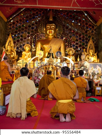 CHIANG MAI, THAILAND - FEBRUARY 4: Buddhist monks praying on evening religion ceremony in Doi Suthep Wat on February 4, 2012 in Chiang Mai, Thailand - stock photo