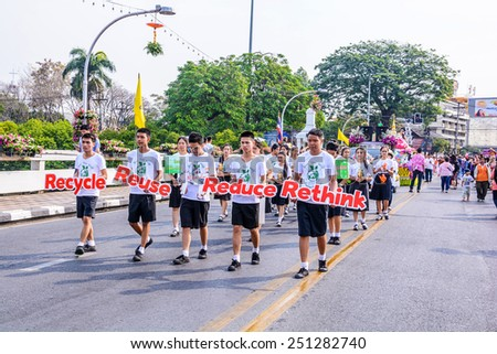 CHIANG MAI,THAILAND-FEBRUARY 07 :Unidentified peoples are in parade with fresh flowers decorate car in annual 39th Chiang Mai Flower Festival,  on February 07, 2015 in Chiang Mai,Thailand.