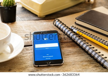 CHIANG MAI,THAILAND - JAN 15, 2016: Facebook icons on Apple iPhone 6 plus. Facebook is largest and most popular social networking site in the world. - stock photo