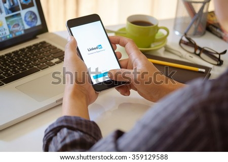 CHIANG MAI,THAILAND JAN - 3 - 2015 : iPhone 6 plus with social network service LinkedIn on the screen. iPhone 6 plus was created and developed by the Apple inc. - stock photo