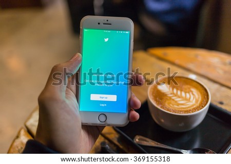 CHIANG MAI, THAILAND - JANUARY 25, 2016: A man trying to log in Twitter application using Apple iPhone 6S. Twitter is largest and most popular social networking site in the world. - stock photo