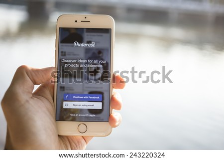 CHIANG MAI, THAILAND - JANUARY 04, 2015: Close-up shot of brand new Apple iPhone 6 with Pinterest application login on a screen. - stock photo