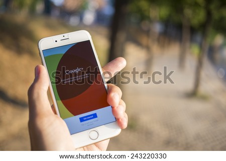 CHIANG MAI, THAILAND - JANUARY 04, 2015: Man hold Apple iphone 6 with Google+ social network of the Google company. Information of a social network, influences Google search results. - stock photo