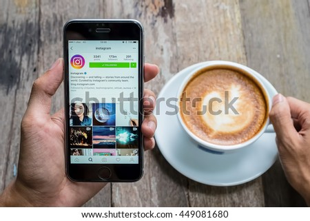 CHIANG MAI, THAILAND - JUL 7,2016: A women holds Apple iPhone 6S with Instagram application on the screen. Instagram is a photo-sharing app for smartphones. - stock photo