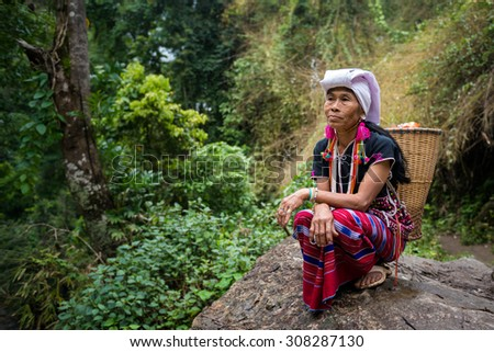 CHIANG MAI, THAILAND - JUL 25 : Karen hill tribe in forest with traditional clothes on July 25, 2015 in Chiang Mai, Thailand.