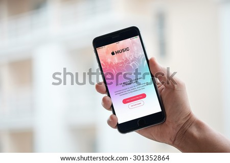 CHIANG MAI,THAILAND - JULY 30,2015:  A man hand holding screen shot of Apple music app showing on iPhone 6 plus. Apple Music is the new iTunes-based music streaming service that arrived on iPhone. - stock photo