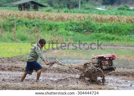 Chiang Mai, Thailand - July 29, 2015: Farmers were plowing in preparation for planting in Mae Chaem District, Chiang Mai. Northern Thailand.