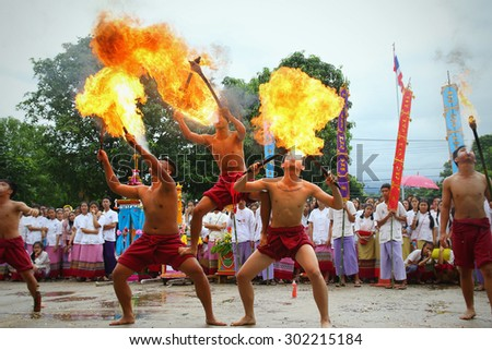 Chiang Mai, Thailand - July 29, 2015:  Performing arts fire sword dance, The arts of the ancient Lanna or ancient people of northern Thailand.