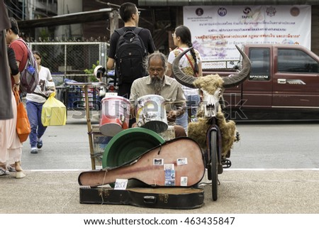 Chiang Mai, Thailand - June 14, 2015: A musician plays his drum kit custom-built, show in exchange for donations at the Sunday Walking Street night Market.on June 14 , 2015 in Chiang Mai.