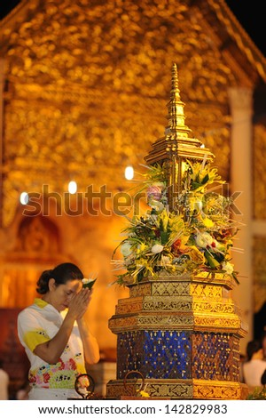 CHIANG MAI THAILAND-JUNE 5 : Inthakhin traditional Offering of flower.Unidentified woman are offering flower to traditional city pillar shrine Chedi Luang temple.on June 5,2013 in Chiangmai Thailand