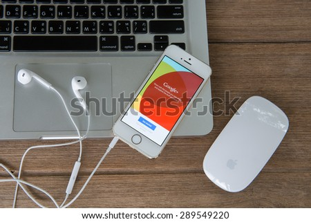 CHIANG MAI, THAILAND -JUNE 22, 2015: iPhone opened to google plus homepage. Googleplus, share and discover everything on Googleplus. - stock photo