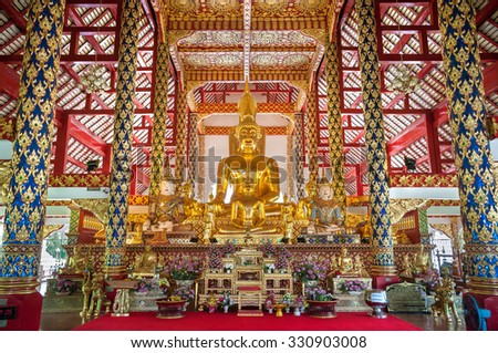 CHIANG MAI, THAILAND - JUNE 6, 2015 - Large golden Buddha at Wat Suan Dok, Chiang Mai, Thailand. Wat Suan Dok is a Buddhist temple housing a 4.70 m (15.4 ft) high bronze Buddha statue cast in 1504. - stock photo
