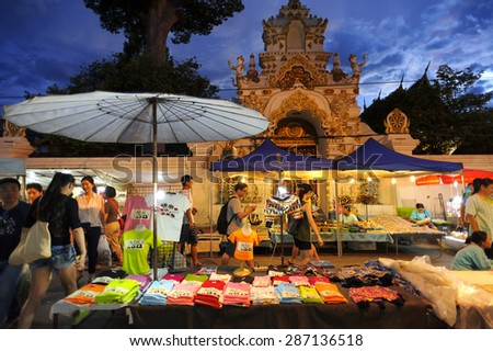 CHIANG MAI THAILAND - JUNE 14 : Sunday market walking street, The city center Thai temple marketing and trading of local tourists come to buy souvenirs. on June 14, 2015 in Chiang Mai, Thailand. - stock photo