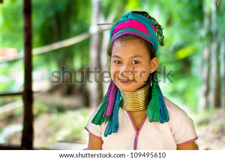 CHIANG MAI, THAILAND - JUNE 13: Unidentified Karen tribe girl poses for the camera in Chiang Mai on June 13, 2012. The Karen people wear brass rings around their neck from as young as five years old. - stock photo