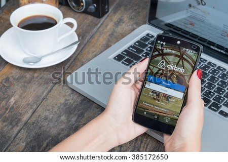 CHIANG MAI, THAILAND -March 2, 2016:LG Nexus 5 open Airbnb application on the screen. Airbnb is a website for people to list, find, and rent lodging. - stock photo