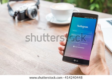 CHIANG MAI, THAILAND - MAY 2, 2016: Man hand holding LG G4 with Google Maps application o. Google Maps is a service that provides information about geographical regions and sites around the world. - stock photo