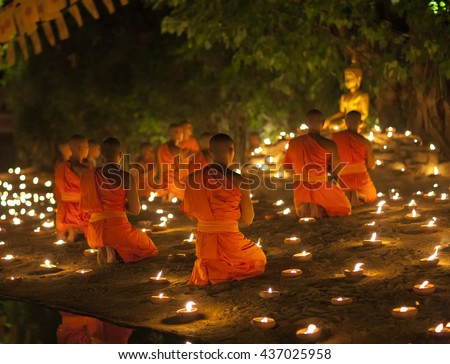 CHIANG MAI, THAILAND - MAY 20: Thai Buddhist monks meditate with candle lighting during the religious ceremony to Visakha Bucha on MAY 20, 2016 at Wat Phan Tao temple in Chiang Mai,Thailand.