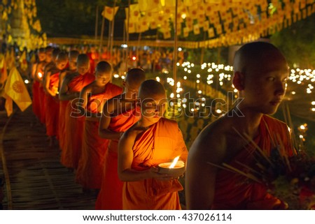 CHIANG MAI, THAILAND - MAY 20: Thai Buddhist monks meditate with candle lighting during the religious ceremony to Visakha Bucha on MAY 20, 2016 at Wat Phan Tao temple in Chiang Mai,Thailand. - stock photo