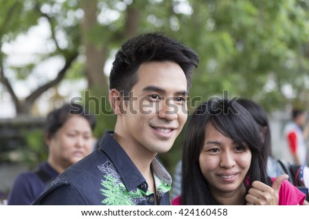 Chiang Mai, Thailand - May 21, 2016: Thanawat Wattanaputi or Pope (nickname), famous Thai actor, taking photo with his fan club at Toyota street fun festival in Chiang Mai, Thailand on May 21, 2016.