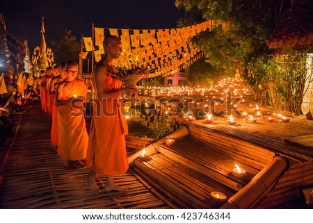 CHIANG MAI, THAILAND -MAY 20, 2016: Young Buddhist monks in religious activities in Visakha Puja Day at the Wat Pan Tao temple, Celebration is commemorate Buddha's birth, enlightenment and death. - stock photo