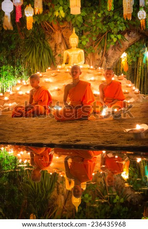 CHIANG MAI, THAILAND - NOV 08 : Buddhist monks meditation front side Buddha in Loy Kratong Festival, Wat Pan Tao Temple, Chiangmai, Thailand 2014 - stock photo