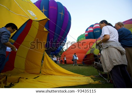 CHIANG MAI, THAILAND - NOV 26 : Participants prepares balloon during Thailand balloon festival 2011 at Prince Royal college in Chiangmai, Thailand on Nov 26, 2011.