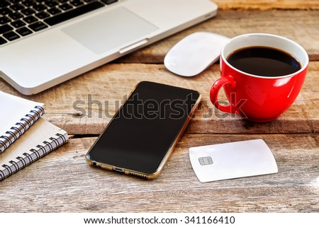 CHIANG MAI,THAILAND - NOV 19,2015 smart phone, notebook and, Cassette tape, cup of coffee. on the wood table