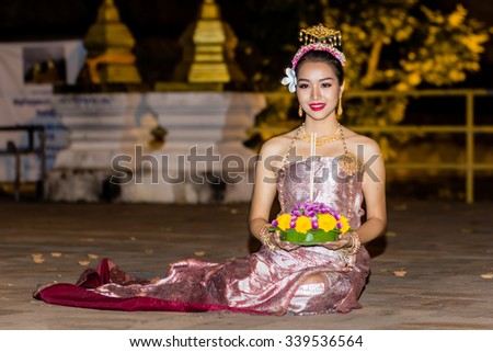 CHIANG MAI,THAILAND-NOVEMBER 13,2015 : Asian woman wearing typical thai dress and hold kratong, identity culture of thailand,Loy Kratong Festival ,NOVEMBER 13,2015 in Chiang Mai Thailand - stock photo
