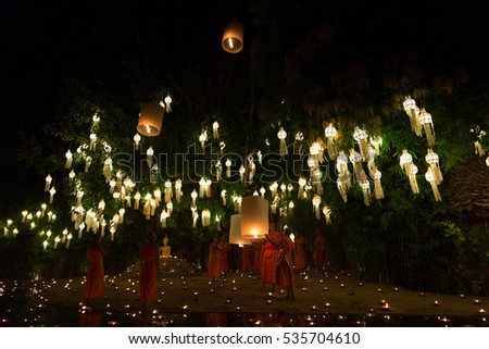 Chiang Mai, Thailand - November 14, 2016: buddhist monk floating hot air balloon in Yeepeng and Loy Krathong festival at Puntao temple in Chiang Mai, Thailand on November 14, 2016.